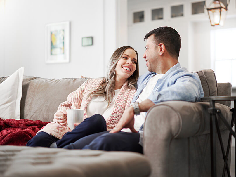 Man and Woman Sitting On The Couch